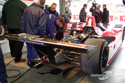 The crew works on the LMP675 AER-powered Courage C65