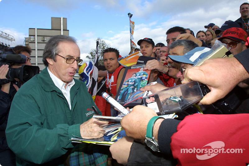 The always popular Jackie Stewart signs autographs