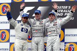 The podium: race winner David Coulthard with Juan Pablo Montoya and Kimi Raikkonen