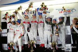 The podium: race winners Frank Biela, Marco Werner and Phillip Peter celebrate with Stefan Johansson, Emanuele Pirro, J.J. Lehto and Johnny Herbert, David Brabham, Mark Blundell