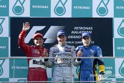 The podium: race winner Kimi Raikkonen with Rubens Barrichello and Fernando Alonso