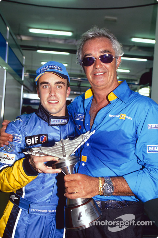 Fernando Alonso celebrates podium finish with Flavio Briatore