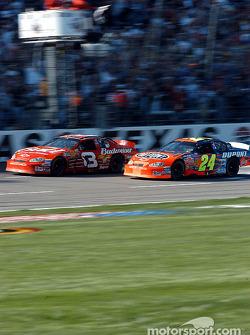 Dale Earnhardt Jr. battles with Jeff Gordon