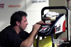 Minardi team member prepares a nose cone