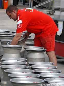Ferrari team member prepares the wheels