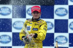 The podium: champagne for Giancarlo Fisichella