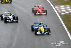 Jarno Trulli, Ralf Schumacher y Michael Schumacher