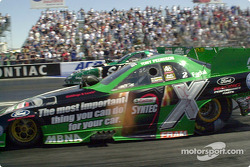 Tony Pedregon passes Ron Capps on his way to victory