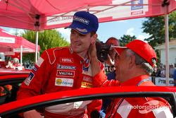 Corrado Provera congratulates rally winner Marcus Gronholm