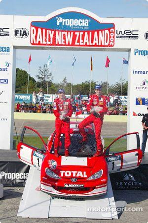 The podium: winners Marcus Gronholm and Timo Rautiainen celebrate