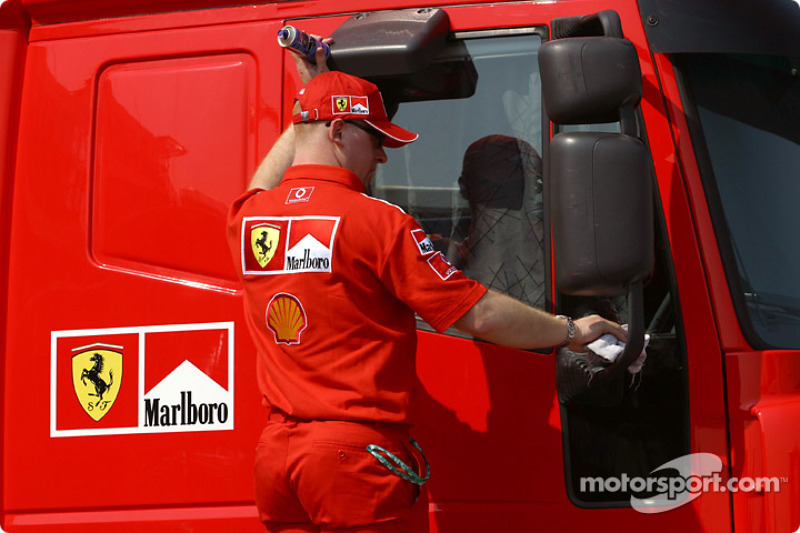 Ferrari team member cleans the transporter