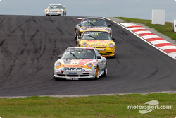 Race legend Jim Richards leads the field during race 1 Carrera Cup support race