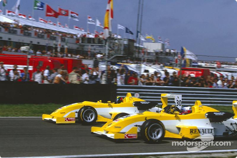 Race winner Fabio Carbone and teammate Heikki Kovalainen