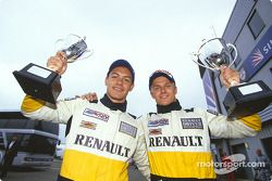 Race winner Heikki Kovalainen and Fabio Carbone