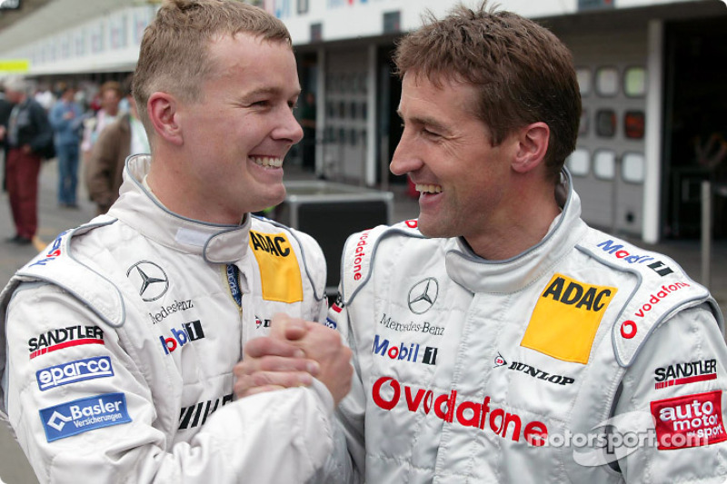 Marcel Fassler and pole winner Bernd Schneider