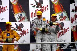 The podium: champagne for race winner Bernd Schneider, Marcel Fassler and Laurent Aiello
