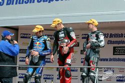 Race 1 podium: winner Shane Byrne with Steve Hislop and Michael Rutter