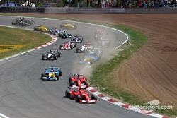 First corner: Michael Schumacher ahead of Rubens Barrichello and Fernando Alonso