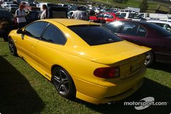 Race goers admire the new Holden GTO coupe