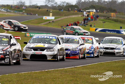 Craig Lowndes caught in the pack after the safety car re-start