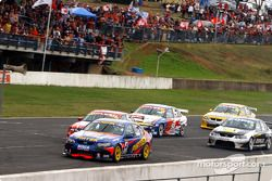 Marcos Ambrose (4) and Craig Lowndes (6) make their move on Mark Skaife (1)