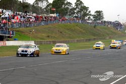 Jason Bargwanna in the Orrcon Ford leads the back markers down pit straight