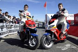 Sébastien Loeb and co-driver Daniel Elena on their scooters
