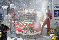 The podium: champagne for winners Marcus Gronholm and Timo Rautiainen