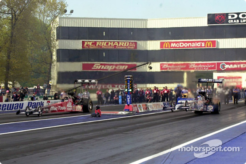 Top Fuel final, Doug Kalitta keeps it on the ground while Larry Dixon reaches for some sky