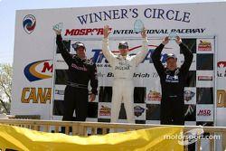 The podium: race winner Scott Pruett with Michael Lewis and Johnny Miller