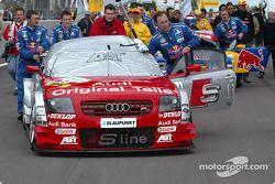 Team Abt-Audi push the car to the grid