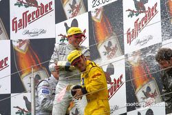 The podium: champagne for race winner Christijan Albers, Marcel Fassler and Laurent Aiello