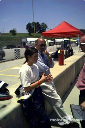 Danica Patrick debriefs with members of the Orbit Racing Team and her CART team owner, Bobby Rahal, after testing an American Le Mans Series car