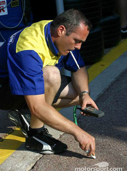 Michelin engineer checks track temperature