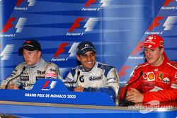 Press conference: race winner Juan Pablo Montoya with Kimi Raikkonen and Michael Schumacher