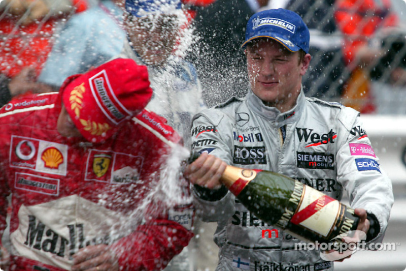 Champagne for Kimi Raikkonen and Michael Schumacher