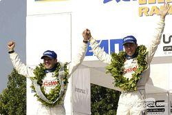 The podium: Markko Martin and codriver Michael Park celebrate victory