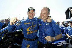 Petter Solberg celebrates victory with David Lapworth