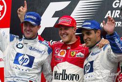 Подиум: Михаэль Шумахер, Ferrari, победитель; Ральф Шумахер, Williams, второе место, и Хуан-Пабло Монтойя, Williams, третье место