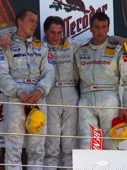 The podium: race winner Christijan Albers with Marcel Fassler and Bernd Schneider