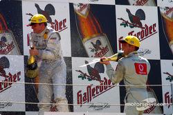 The podium: champagne for race winner Christijan Albers and Bernd Schneider