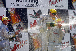 The podium: champagne for race winner Christijan Albers, Marcel Fassler and Bernd Schneider