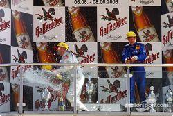 The podium: champagne for Bernd Schneider and Mattias Ekström