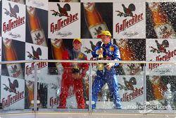 The podium: champagne for Peter Dumbreck and Mattias Ekström