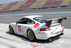 The #25 Rosser Racing Porsche GT3 RS leaves the pits after getting a quick splash of fuel with 10 laps to go in the Grand American 400.