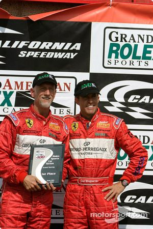 Brent Martini (l) and Cort Wagner (r) holding their trophy after finishing 1st in GT at the Grand American 400