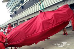 Rubens Barrichello's car back on the flatbed truck