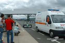 Mark Webber towed back to the pits