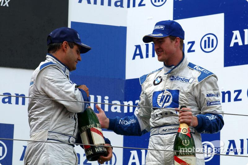 Le podium : le vainqueur Ralf Schumacher et Juan Pablo Montoya