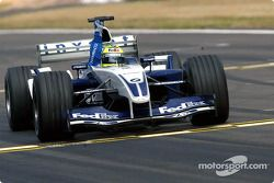 Ralf Schumacher takes the checkered flag